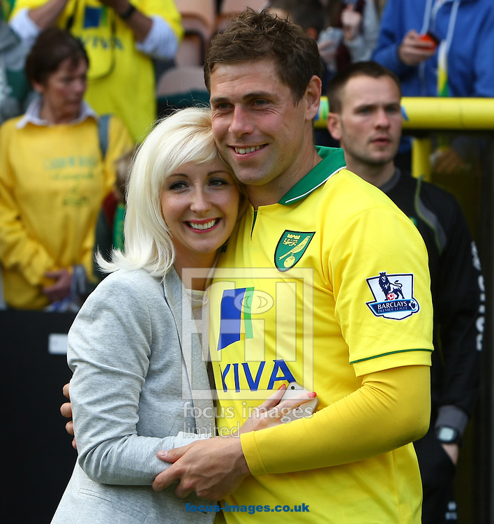 Picture by Paul Chesterton/Focus Images Ltd.  07904 640267.13/05/12.Grant Holt of Norwich and his wife after the Barclays Premier League match at Carrow Road Stadium, Norwich.