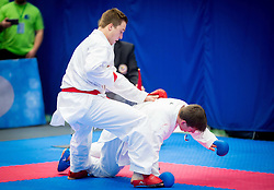 Luka Debersek (red) of Slovenia fighting against Team of Hungary (blue) during of Kumite Team male at Day Two of Karate 1 World Cup - Thermana Slovenia Lasko 2014 tournament, on March 16, 2014 in Arena Tri Lilije, Lasko, Slovenia.Photo by Vid Ponikvar / Sportida