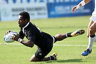Tomasi Cama dives over for a try for New Zealand during the semi final of the medal competition of the Rugby Sevens between New Zealand and England held at Delhi University as part of the XIX Commonwealth Games in New Delhi, India on the 12 October 2010..Photo by:  Ron Gaunt/photosport.co.nz