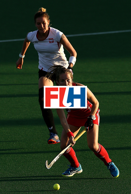 JOHANNESBURG, SOUTH AFRICA - JULY 10:  Shona McCallin of England controls the ball from Bianca Strubbe of Poland during day 2 of the FIH Hockey World League Semi Finals Pool A match between England and Polandat Wits University on July 10, 2017 in Johannesburg, South Africa.  (Photo by Jan Kruger/Getty Images for FIH)