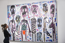 March 29, 2019 - London, UK - A staff member views ''Untitled'', 2014, by Abdoulaye Aboudia Diarrassouba (Est. GBP 10,000-15,000).  Preview of Sotheby's upcoming Modern and Contemporary African Art sale.  Works from artists across the African diaspora will be offered for sale on 2 April. (Credit Image: © Stephen Chung/London News Pictures via ZUMA Wire)