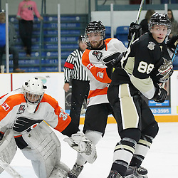 TRENTON, ON - SEP 16:  Daniel Barnes #2 of the Orangeville Flyers and Michael Silveri #88 of the Trenton Golden Hawks battle for position in front of the net during the OJHL regular season game between the  Orangeville Flyers and Trenton Golden Hawks on September 16, 2016 in Trenton, Ontario. (Photo by Amy Deroche/OJHL Images)