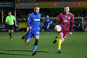 AFC Wimbledon attacker Shane McLoughlin (19) dribbling and battles for possession during the EFL Sky Bet League 1 match between AFC Wimbledon and Ipswich Town at the Cherry Red Records Stadium, Kingston, England on 11 February 2020.