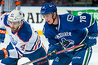 PENTICTON, CANADA - SEPTEMBER 11: Evan Polei #41 of Edmonton Oilers faces off against Kole Lind #78 of Vancouver Canucks on September 11, 2017 at the South Okanagan Event Centre in Penticton, British Columbia, Canada.  (Photo by Marissa Baecker/Shoot the Breeze)  *** Local Caption ***