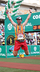 10062018 (Durban) Pieter celebrates for making it to the finnish line at the Mosses Mabhida stadium venue during the Comrades Marathon on Sunday as Bong'musa Mthembu and Ann Ashworth ensured that the coveted titles remained on these shores.<br /> Picture: Motshwari Mofokeng/African News Agency/ANA