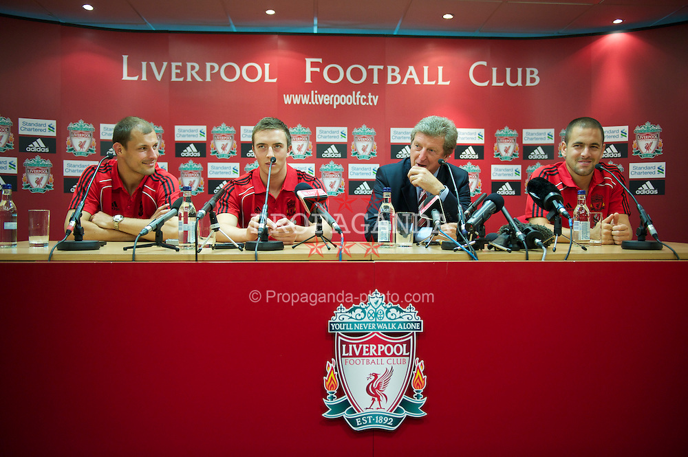 LIVERPOOL, ENGLAND - Tuesday, July 27, 2010: Liverpool FC's new signings Milan Jovanovic, Danny Wilson and Joe Cole with manager Roy Hodgson during a press conference at Anfield. (Pic by David Rawcliffe/Propaganda)