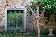 An old green door complements this Croatian arbor.