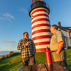 Park Ranger Shawn Goggin talks to a visitor at the West Quoddy Head Lighthouse in Lubec, Maine.