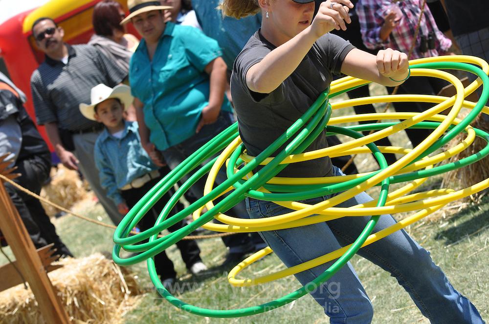 Brooke Lindo, 12, make a record ten hula hoops dance at Sunday's final Day of Champions at the California Rodeo Salinas.