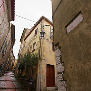 Enjoying a stroll through an ancient Roman village in France on a cloudy day. Remarkable time travel through a still inhabited village on the hills overlooking Monaco.