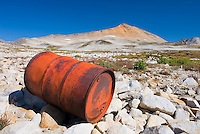 Fuel drums abandoned by miners and left to rust and leak into the wilderness watershed of Salal Creek, Coast Mountains British Columbia