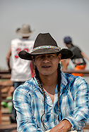 Saddle Bronc rider, Marty Youngbear, Three Affiliated Tribes, Crow Fair Rodeo, Crow Indian Reservation, Montana