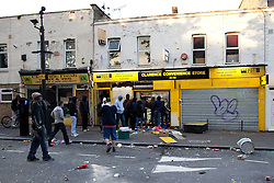 © Licensed to London News Pictures. 08/08/2011. London, UK. Looters and rioters in Hackney, where bins have been set alight, rocks have been thrown, cars smashed and set alight and people have been fighting running battles with riot police. Photo credit : Joel Goodman/LNP