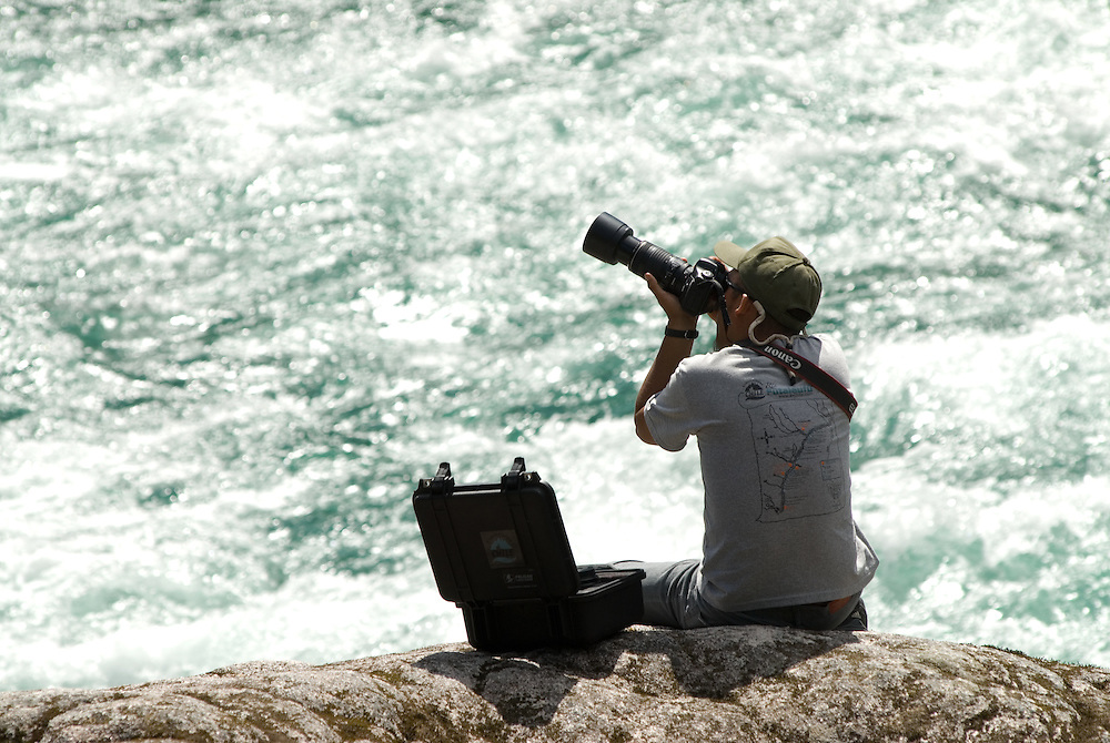Photographer on the edge of Chile's Futaleufu River.