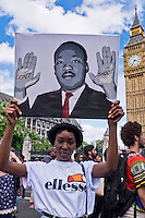 "Image of  Martin Luther King at ""Black Lives Matter"" Rally.  Over a thousand people marched through London chanting ""hands up don't shoot"".  The black community was outraged by US police brutality after killing of two black men - one in Minnesota and one in Louisiana."