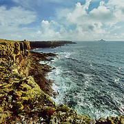 This beautiful view is along the cliffs at the southwest end of the island with the offshore skerries and Atlantic Ocean in the distance. I also watched basking sharks from that side of the island and saw some dolphins just offshore. It was one of my favourite palces to watch the fulmars demonstrating their aerial skills. This was the windward side of the island facing the turbulence and swells of the open ocean, and a magnificent location to look down at the waves crashing forcefully against the rocks below. There was the occasional boat that visited the island during the time that I stayed there but most of the time I had it to myself, and it gave me a wonderful feeling of coastal maritime solitude that I have rarely, if ever, experienced in the UK. I could have stayed there for at least another month but there were still other islands to visit and explore on this trip.