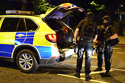 """Armed police on Borough High Street as police have confirmed that incidents at London Bridge and Borough Market are """"terrorist incidents"""", following reports of a vehicle ploughing into pedestrians on a bridge and stabbings."""