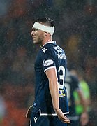 30th August 2019; Dens Park, Dundee, Scotland; Scottish Championship, Dundee Football Club versus Dundee United; Jordan McGhee of Dundee bandaged after a head injury