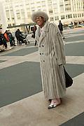 Arthur Gonsalves in a mink coat and hat.