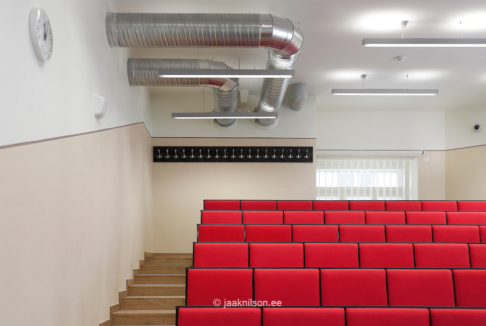 Lecture room with red seats in Tartu University, Estonia