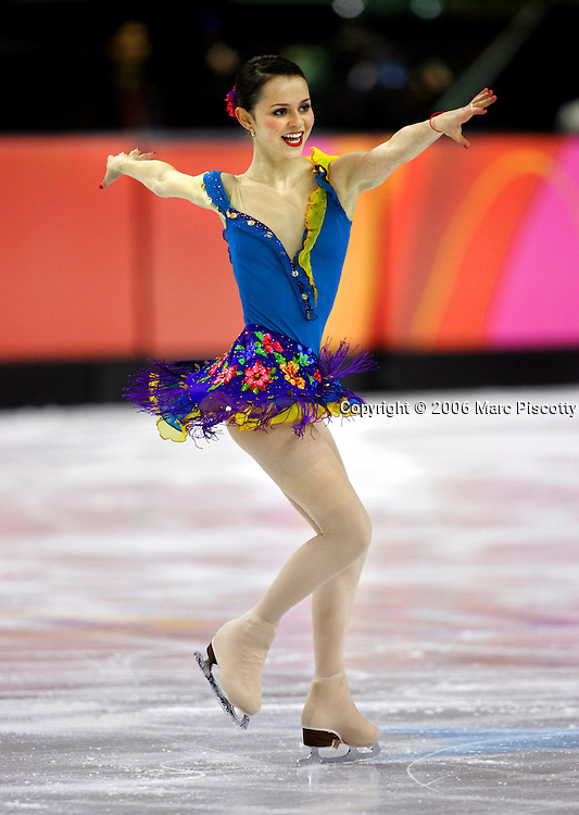 U.S. figure skater Sasha Cohen performs during the Short Program of the Women's Figure Skating competition at the Palavela ice arena in Turin, Italy on February 21, 2006. U.S. figure skater Sasha Cohen leads in the event with a score of 66.73. Teammate Kimmie Meissner is in fifth with 59.40 points and Emily Hughes is in seventh with 57.08..(Photo by Marc Piscotty / © 2006)
