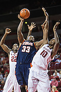 FAYETTEVILLE, AR - DECEMBER 19:  Myles Taylor #33 of the UT Martin Skyhawks goes up for a shot against Bobby Portis #10 of the Arkansas Razorbacks at Bud Walton Arena on December 19, 2013 in Fayetteville, Arkansas.  The Razorbacks defeated the Skyhawks 102-56.  (Photo by Wesley Hitt/Getty Images) *** Local Caption *** Myles Taylor; Bobby Portis