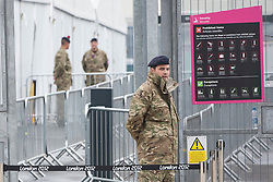 © licensed to London News Pictures. London, UK 20/07/2012. Soldiers guarding an entrance of the Olympic site on 20/07/12. Photo credit: Tolga Akmen/LNP