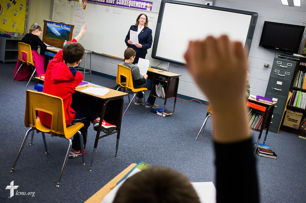 Deaconess Kelly Hardt teaches religion at Holy Cross Lutheran Church and School on Friday, Feb. 21, 2014, in Collinsville, Ill.  LCMS Communications/Erik M. Lunsford