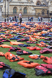 Parliament Square, London, September 19th 2016. 2,500 lifejackets make up a lifejacket graveyard in London's Parliament Square to highlight the plight of refugees as world leaders meet in New York for the United Nations Migration Summit. The lifejackets are those actually worn by refugees during treacherous sea crossings from Africa and Turkey into Europe. ©Paul Davey<br /> FOR LICENCING CONTACT: Paul Davey +44 (0) 7966 016 296 paul@pauldaveycreative.co.uk