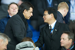 CARDIFF, WALES - Tuesday, January 24, 2012: New Wales manager Chris Coleman shakes hands with Cardiff City's owner and Chairman Datuk Chan Tien Ghee before the Football League Cup Semi-Final 2nd Leg against Crystal Palace at the Cardiff City Stadium. (Pic by David Rawcliffe/Propaganda)