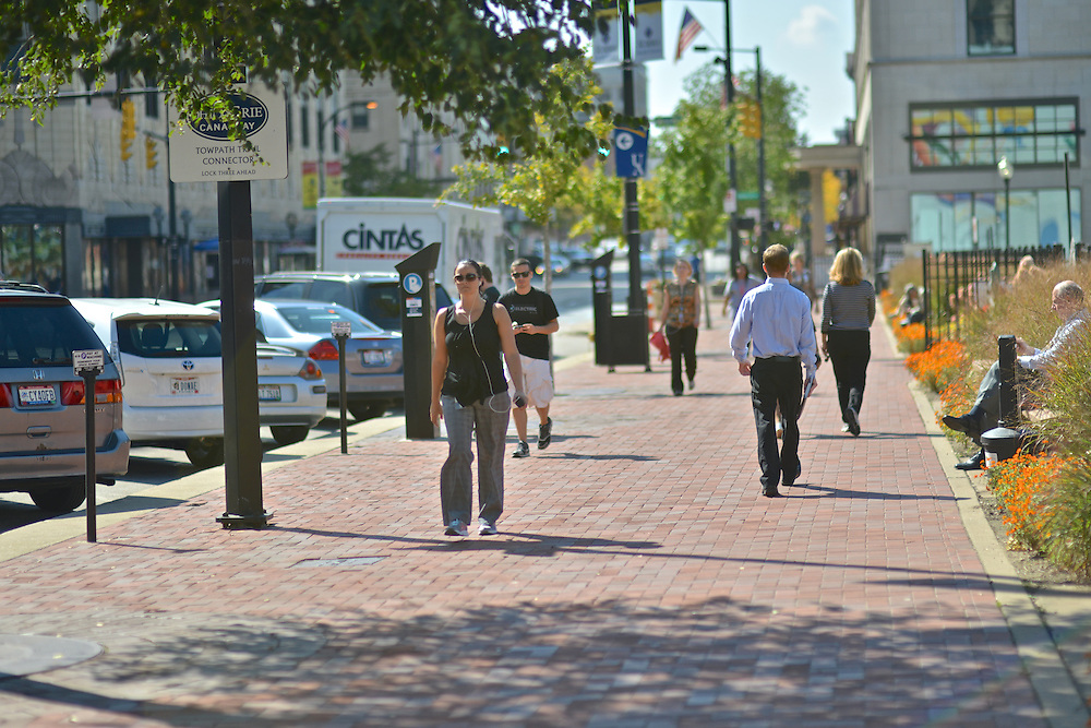 Pedestrians walking downtown outside of Lock 3.