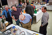 Guests check out gift baskets for the silent auction during the Milpitas Chamber of Commerce Crab Feed at Napredak Hall in San Jose, California, on March 6, 2015. (Stan Olszewski/SOSKIphoto)