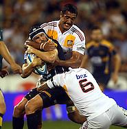 Matt Giteau tackled by Romana Graham.Super 14 rugby union match, Brumbies v Cheifs, Canberra, Australia. Saturday 19 February 2011. Photo: Paul Seiser/PHOTOSPORT.../SPORTZPICS