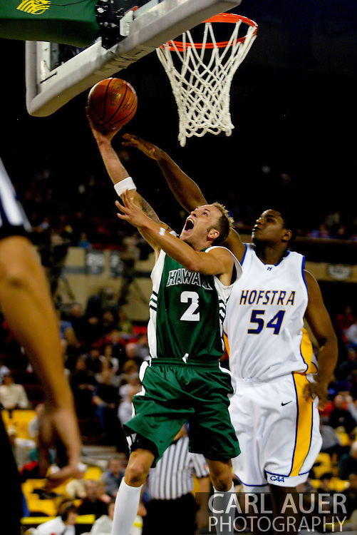 11/23/2006 - Anchorage, Alaska: Junior guard Matt Gibson (2) of the Hawaii Warriors tries to lay the ball in past Sophomore forward/center Chris Gadley (54) of the Hofstra Pride as Hawaii defeats Hofstra 80-79 at the 2006 Great Alaska Shootout on Thanksgiving night<br />