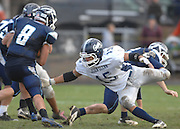 John Glenn's Devin McCulloh (15) reaches out for Northman running back Joe Robbins (8) during the Bobcat's playoff loss to Petoskey.