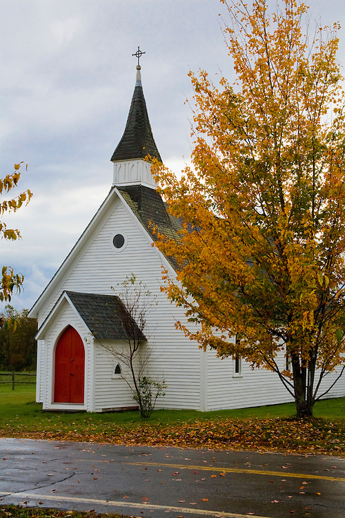 White sided church with red door in village of Lost Nation.