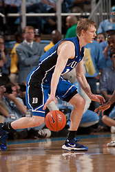 CHAPEL HILL, NC - MARCH 05: Kyle Singler #12 of the Duke Blue Devils dribbles the ball while playing the North Carolina Tar Heels on March 05, 2011 at the Dean E. Smith Center in Chapel Hill, North Carolina. North Carolina won 67-81. (Photo by Peyton Williams/UNC/Getty Images) *** Local Caption *** Kyle Singler