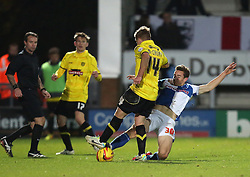Bristol Rovers' Tom Lockyer tackles Burton Albion's Damien McCrory- Photo mandatory by-line: Matt Bunn/JMP - Tel: Mobile: 07966 386802 23/11/2013 - SPORT - Football - Burton - Pirelli Stadium - Burton Albion v Bristol Rovers - Sky Bet League Two