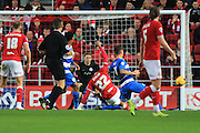 Queens Park Rangers defender Grant Hall blocks Bristol City forward Jonathan Kodjia's attempt on goal during the Sky Bet Championship match between Bristol City and Queens Park Rangers at Ashton Gate, Bristol, England on 19 December 2015. Photo by Jemma Phillips.