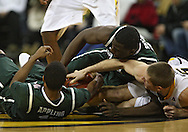 February 2 2011: Michigan State Spartans guard Keith Appling (11), Michigan State Spartans forward Draymond Green (23), and Iowa Hawkeyes guard Matt Gatens (5) battle for a rebound during the first half of an NCAA college basketball game at Carver-Hawkeye Arena in Iowa City, Iowa on February 2, 2011. Iowa defeated Michigan State 72-52.