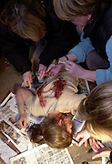 TV SERIES M.I.T..DAY IN THE LIFE of the series..CORPSE ON THE SET - PENNY BARRAL PLAYS JOURNO ELLEN MURDERED IN A DERELICT SHOP..PIC JAYNE RUSSELL.28.4.2003..IN SITU TOUCH UP BY THE MAKE UP DEPARTMENT.