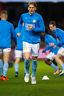 Melbourne City defender Harrison Delbridge (4) warming up at the Hyundai A-League Round 1 soccer match between Melbourne Victory and Melbourne City FC at Marvel Stadium in Melbourne.