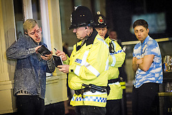© Licensed to London News Pictures . FILE PICTURE DATED 05/05/2013 of police intervening in a domestic dispute resulting in a head injury in Central Manchester overnight as the British Home Secretary , Theresa May , takes questions at the annual Police Federation conference on licensing and policing the night time economy , today (Wednesday 15th May 2013) . Photo credit : Joel Goodman/LNP