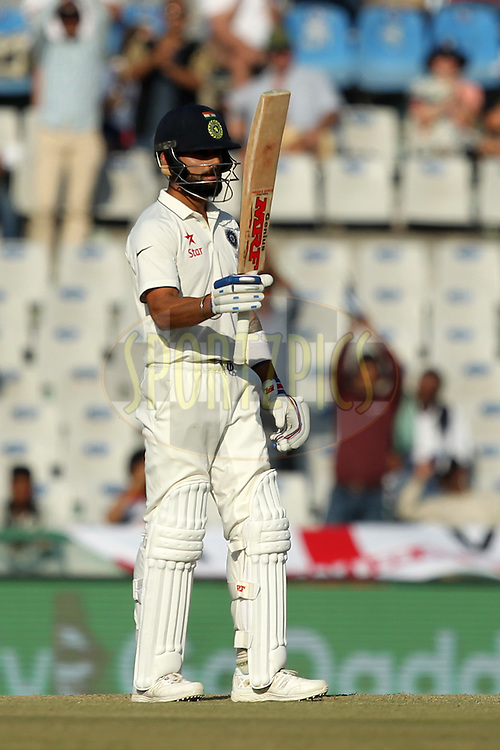 Virat Kohli captain of India celebrates his half century during day 2 of the third test match between India and England held at the Punjab Cricket Association IS Bindra Stadium, Mohali on the 27th November 2016.Photo by: Prashant Bhoot/ BCCI/ SPORTZPICS