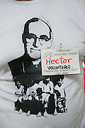 "A name tag on a ""Romero - Martyr of Love"" tshirt.  El Salvador prepares for the beatification ceremony and mass announcing the beatification of Archbishop Oscar Romero. The Archbishop was slain at the alter of his Church of the Divine Providence by a right wing gunman in 1980. Oscar Arnulfo Romero y Galdamez became the fourth Archbishop of San Salvador, succeeding Luis Chavez, and spoke out against poverty, social injustice, assassinations and torture. Romero was assassinated while offering Mass on March 24, 1980."