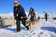 Tourists round up their dog sled team in April near Longyearbyen, Svalbard, Norway.