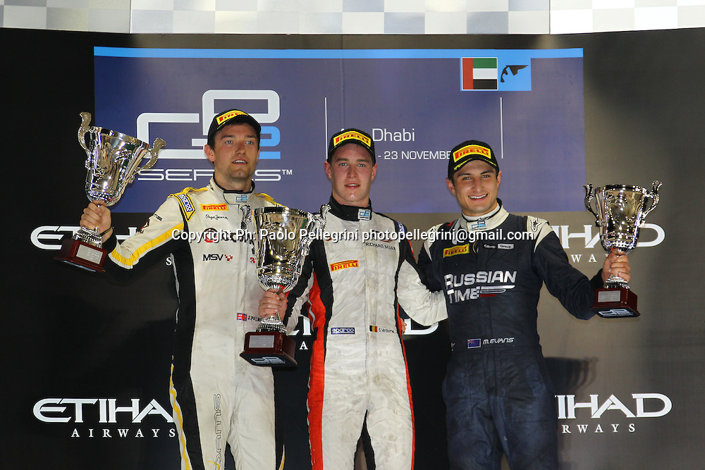 Mitch Evans (NZL) celebrates his 3rd place podium at the final round of the 2014 GP2 series at Yas Marina, Abu Dhabi. 1st Stoffel Vandoorne, 2nd Jolyon Palmer, 3rd Mitch Evans. 22 November 2014. Photo: Paolo Pellegrini/www.photosport.co.nz