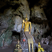 The main Buddha at Tham Phra Prang, a cave located in Khuean Srinagarindra National Park, Thailand.