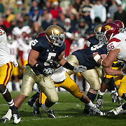 Notre Dame linebacker, Manti Teo prepares to fight off USC Offensive Guard Alex Parsons in an effort to tackle then Trojan, now New York Jet Joe McKnight in the 2009 Trojan 34-27 victory over the Irish.  Photo by Barry Markowitz, 10/17/09, 5pm