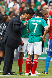 March 26, 2011; Oakland, CA, USA;  Mexico head coach Jose Manuel de la Torre (left) talks to forward Pablo Barrera (7) on the sidelines against Paraguay during the first half at Oakland-Alameda County Coliseum. Mexico defeated Paraguay 3-1.